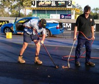 Volunteers resurfacing the racetrack