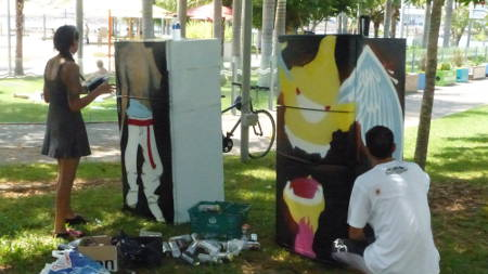 Artists work in the shade beside the wavepool