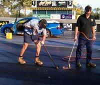 Volunteers resurfacing the racetrack