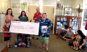 Alawa School accepting cheque