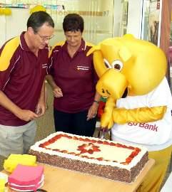 Nightcliff Directors help Piggy cut the birthday cake