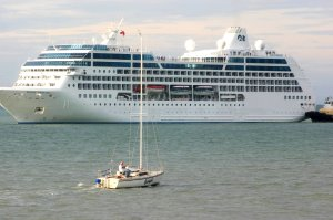 Cruise ship dwarfs local yacht