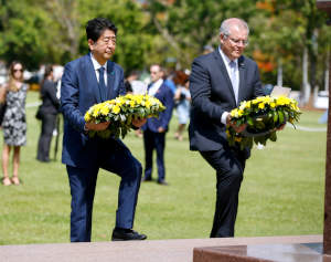Abe and Morrison laying wreaths