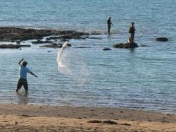 Fishing on a Darwin Beach