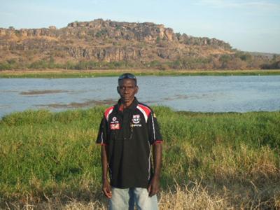 Leslie at the billabong, Gunbalanya, Western Arnhem Land, with the escarpment in the background