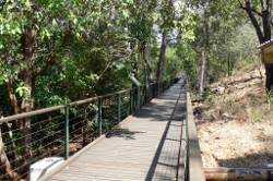A long boardwalk from the pump station to the dam wall