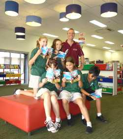 Nightcliff Community Bank manager with students