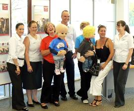 Bank staff with Camp Quality Staff and puppets