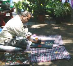 Traditional dot paintings are part of a culture thousands of years old.