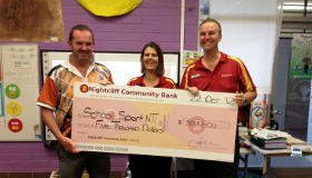Nightcliff Community Bank Branch Manager hands a cheque to NT School Sports