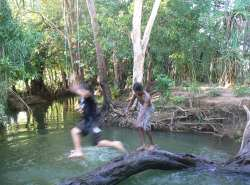 Local boys enjoying a freshwater creek.