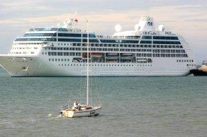 Cruise ship dwarfs local yacht
