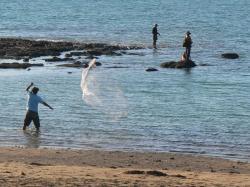 Fishing on a Darwin Beach