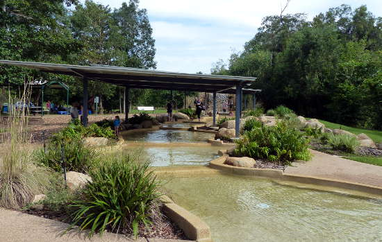 Newly build pools and waterfall provide safe playing for families.