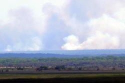 Dry season smoke rising.